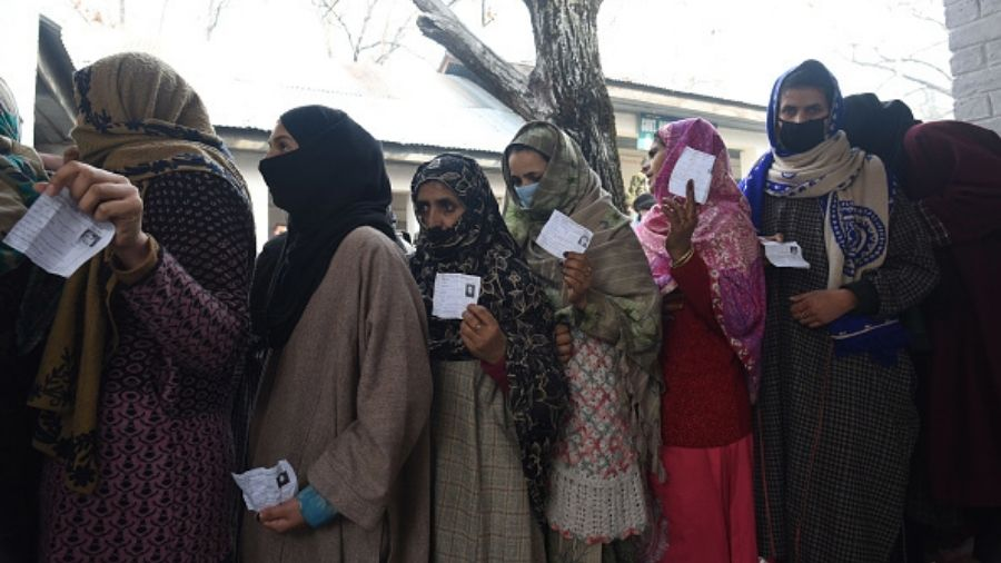 Voters stand in queue during the third phase of the DDC polls at Wurpush area of Ganderbal, Srinagar in December last year.