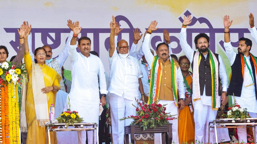 NCP President Sharad Pawar and General Secretary Praful Patel wave at supporters during a party rally, in Ranchi, Sunday