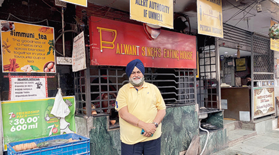 Harvinder Singh, son of Balwant Singh, in front of the well-known eating house.