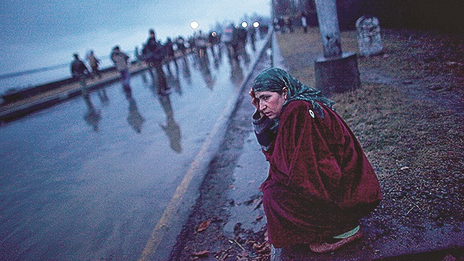 A Kashmiri muslim woman regains her composure as others retreat during a protest of the death of teenager Zahid Farooq on February 05, 2010 on the outskirts of Srinagar, Kashmir, India. Fresh protests erupted today fuelled by the death of of the second teenager in a week, 16 year old student Zahid Farooq. Police are still investigating the death, whilst relatives and friends blamed government forces.