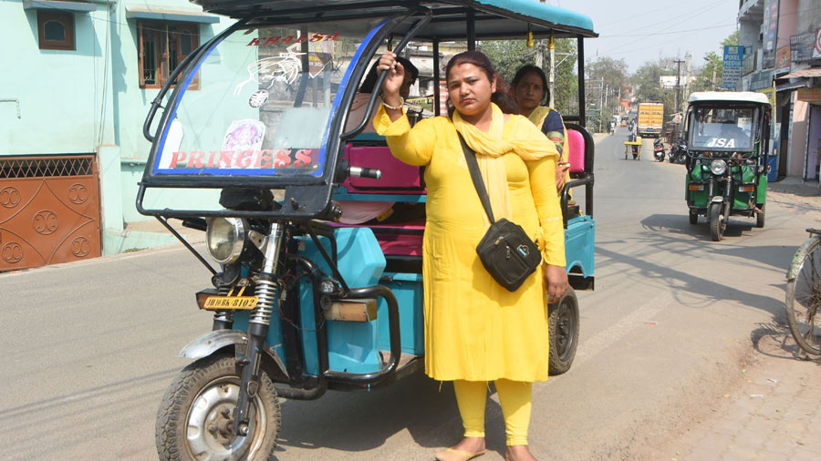Princy Chawla, Dhanbad's only woman e-rickshaw driver waits for passengers on Monday.