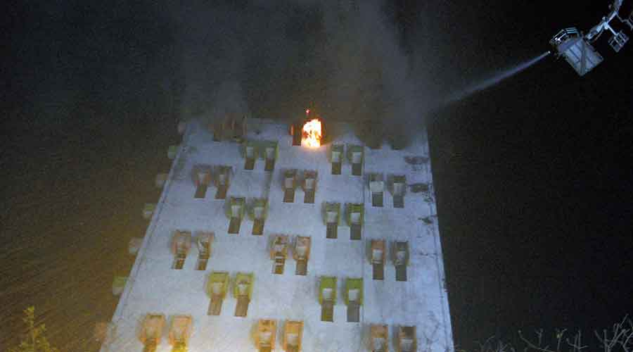 A hydraulic ladder being used to douse the fire.