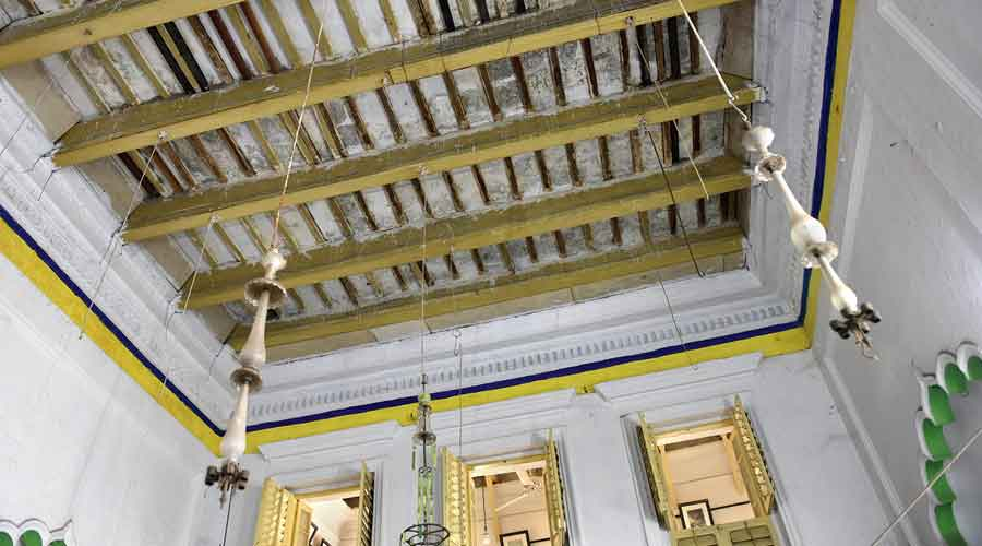 The beams of the ceiling need urgent repair. The chandelier hooks attached to the roof are empty because the trustees have taken them down from the unstable roof.
