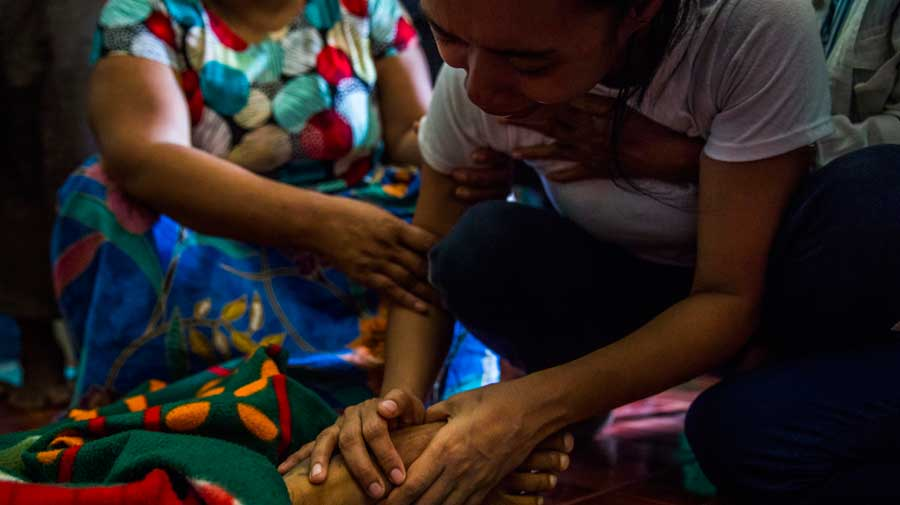 Ma Aye Chan Myint cries while holding the body of her husband Ko Chit Min Thu, who was shot in the head by security forces in Yangon, Myanmar, on Thursday.