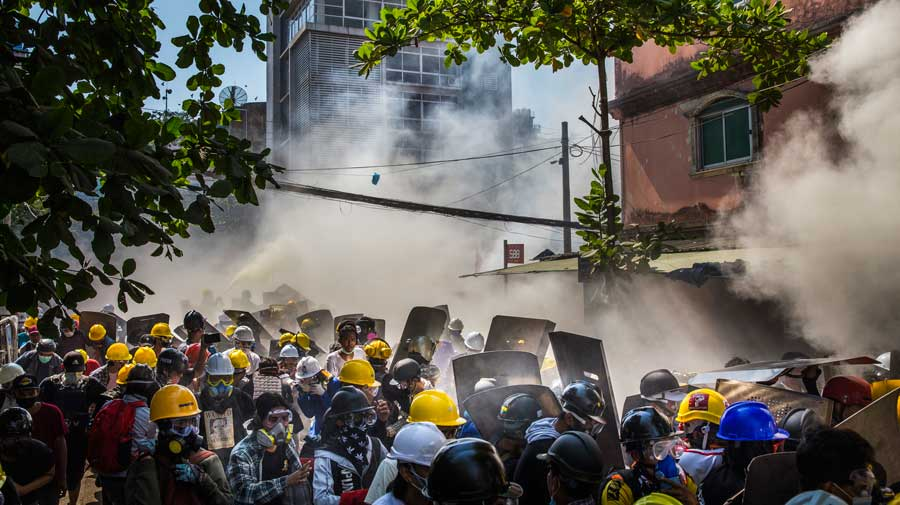 Police use tear gas, sound grenades and rubber bullets to crack down on the demonstrations in Yangon, Myanmar, on Monday.