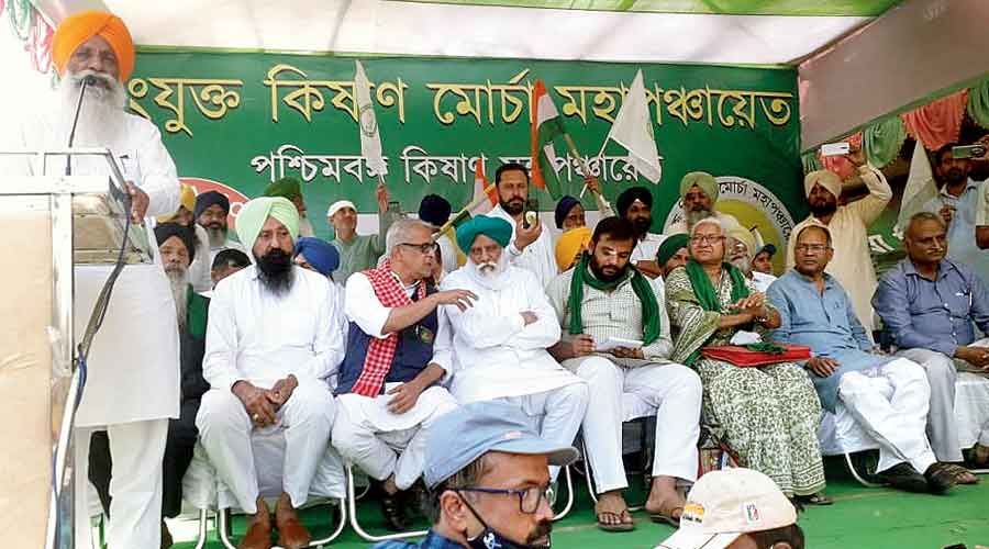 A farm leader speaks at the kisan mahapanchayat