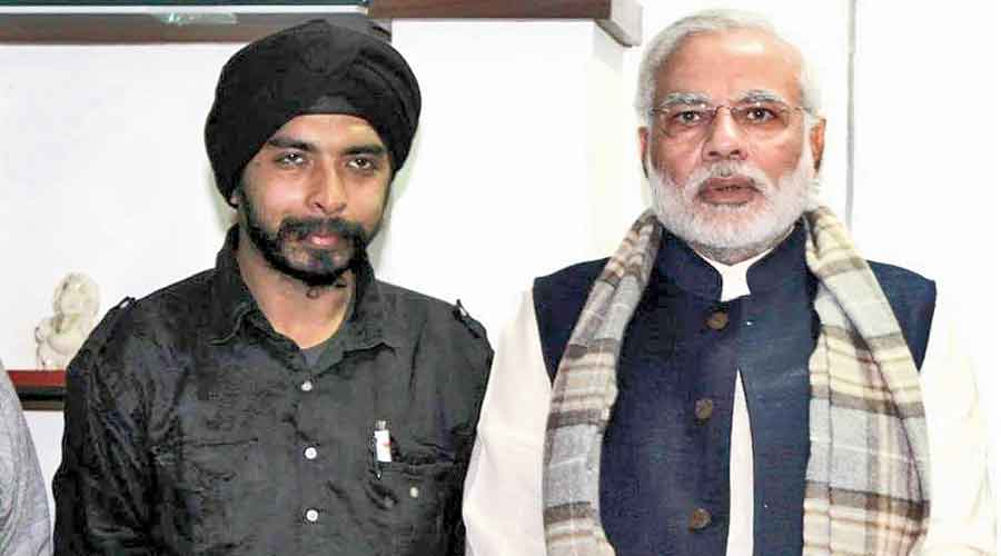 BJP spokesperson Tajinder Pal Singh Bagga with Narendra Modi in a picture from Bagga's Facebook profile