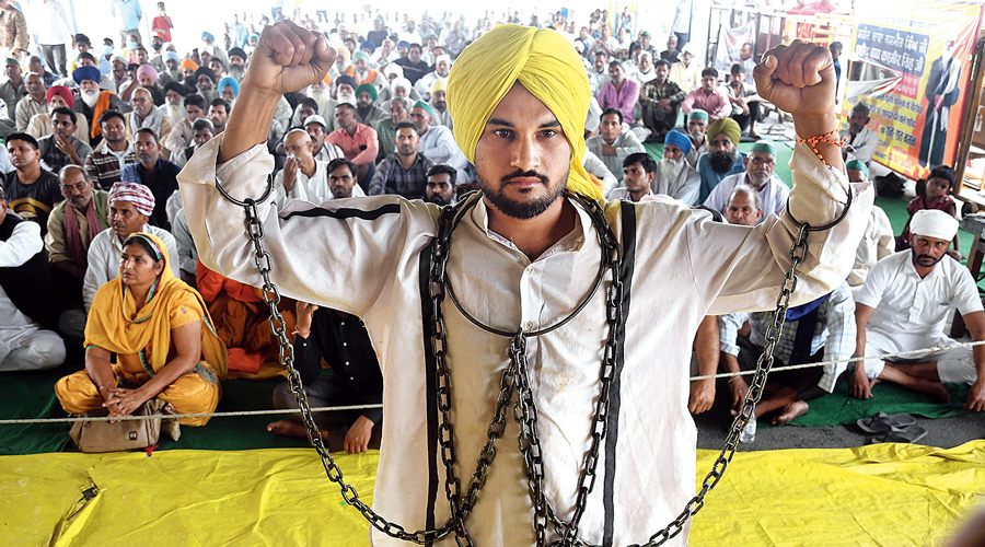 An artiste of the Azad Rang Manch enacts the play Bhagat Singh at the Delhi-Ghazipur border during the farmers' protest on Thursday.