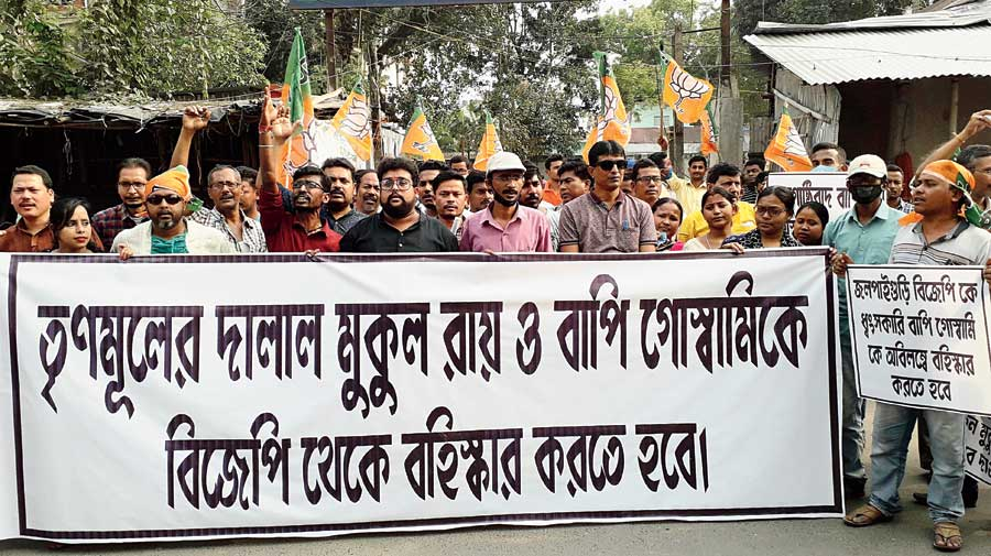 BJP supporters demonstrate in front of the Jalpaiguri district party office, demanding expulsion of some leaders