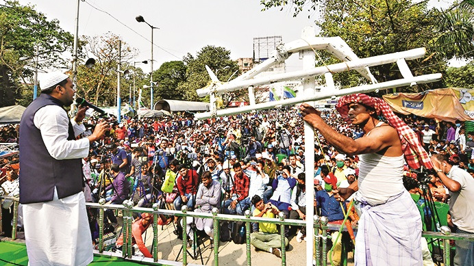 Indian Secular Front (ISF) leader Pirzada Abbas Siddiqui, a cleric of Furfura Sharif Dargah, addresses a protest rally on the ongoing farmers' agitation, in Kolkata, Tuesday, Feb. 23, 2021.