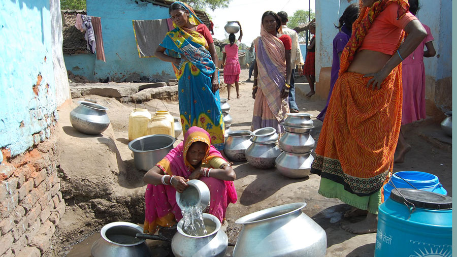 Women collect water from a water tap of Jharia, in Dhanbad on Monday.