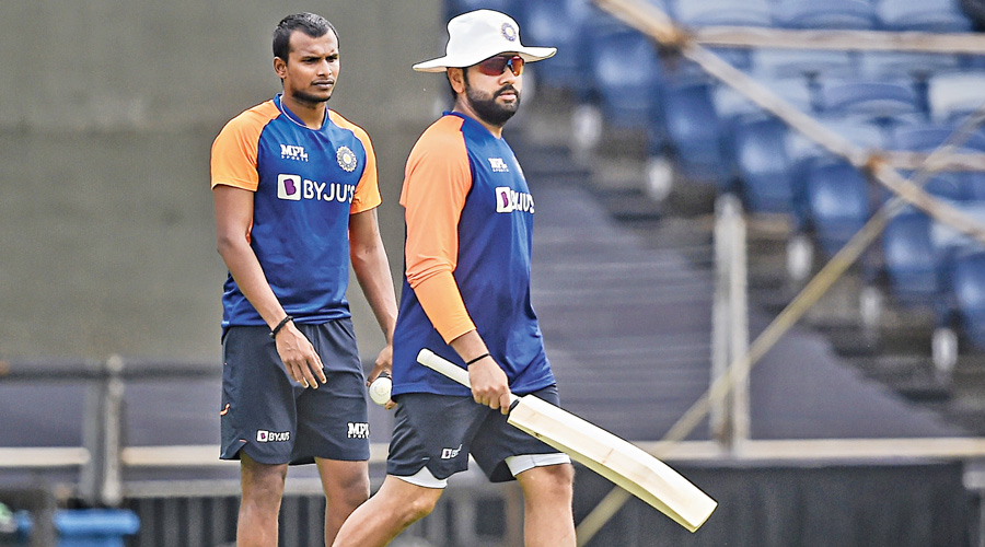 Rohit Sharma and T. Natarajan (left) at a practice session ahead of  the first ODI against England in Pune on Monday.