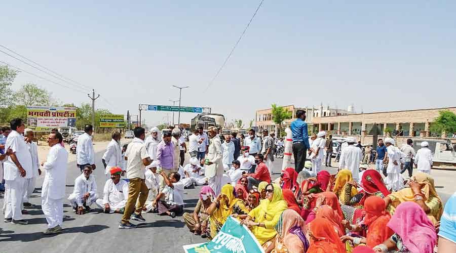 Farmers block railway tracks at Dhablan  village in Punjab