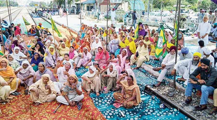Bandh supporters block a road in Jodhpur, Rajasthan, on Friday
