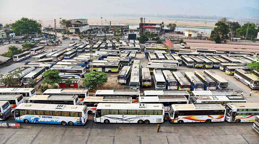 Buses stand parked at a terminal  in Vijayawada, Andhra Pradesh