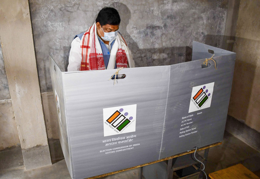 Congress leader Rokibul Hussain casts his vote during in the first phase of polling for Assam Assembly elections, in Nagaon district on Saturday.