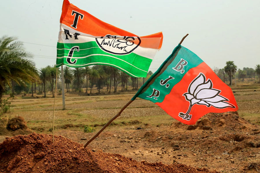 Flags of BJP and TMC flutter side by side in Ooro village under Jhargram district on Saturday