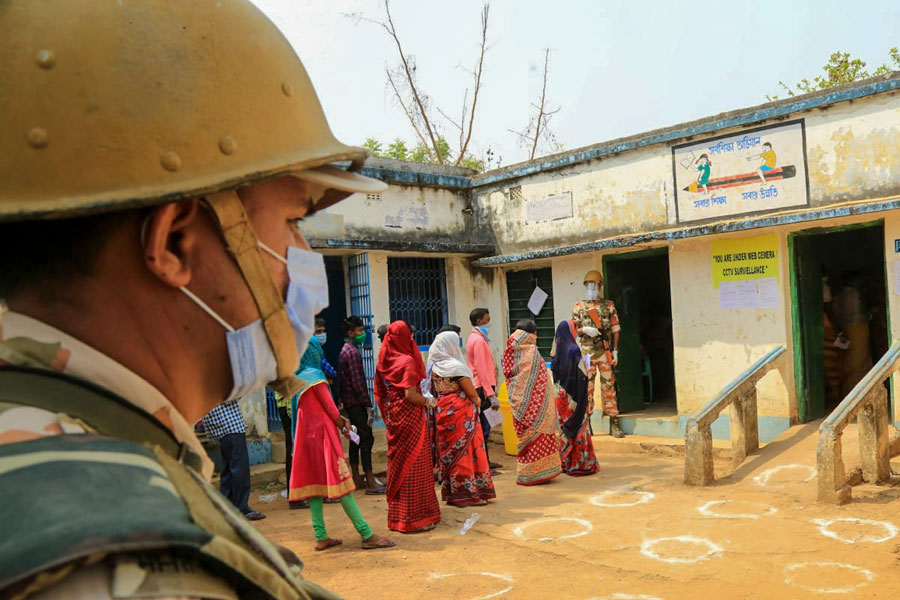 Security persons keep a tight vigil during the 1st phase of Assembly Election in the sensitive naxal infested Ooro village under Jhargram district on Saturday