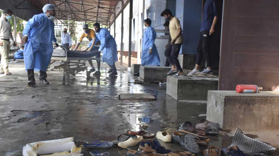 A bed is shifted in a hall after a fire broke out in the LPS Institute of Cardiology in Kanpur on Sunday. There were around 150 patients in the hospital, including 10 in the ICU, at the time.