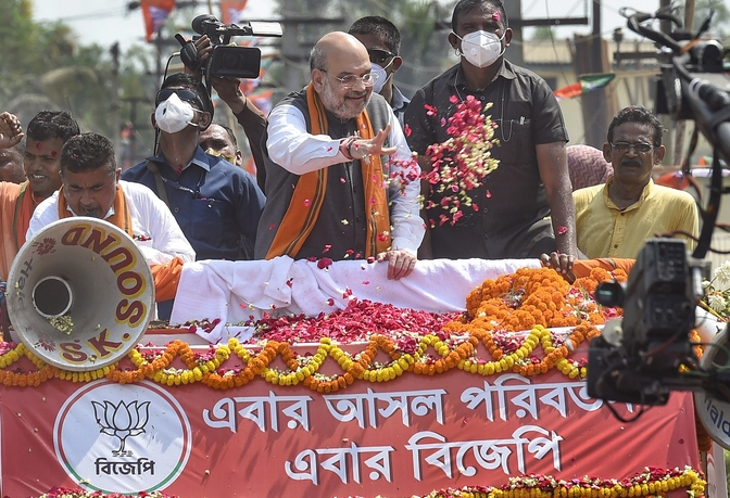 Union home minister Amit Shah greeted with flowers as he campaigns for BJP candidate Suvendu Adhikari at Nandigram on Tuesday.
