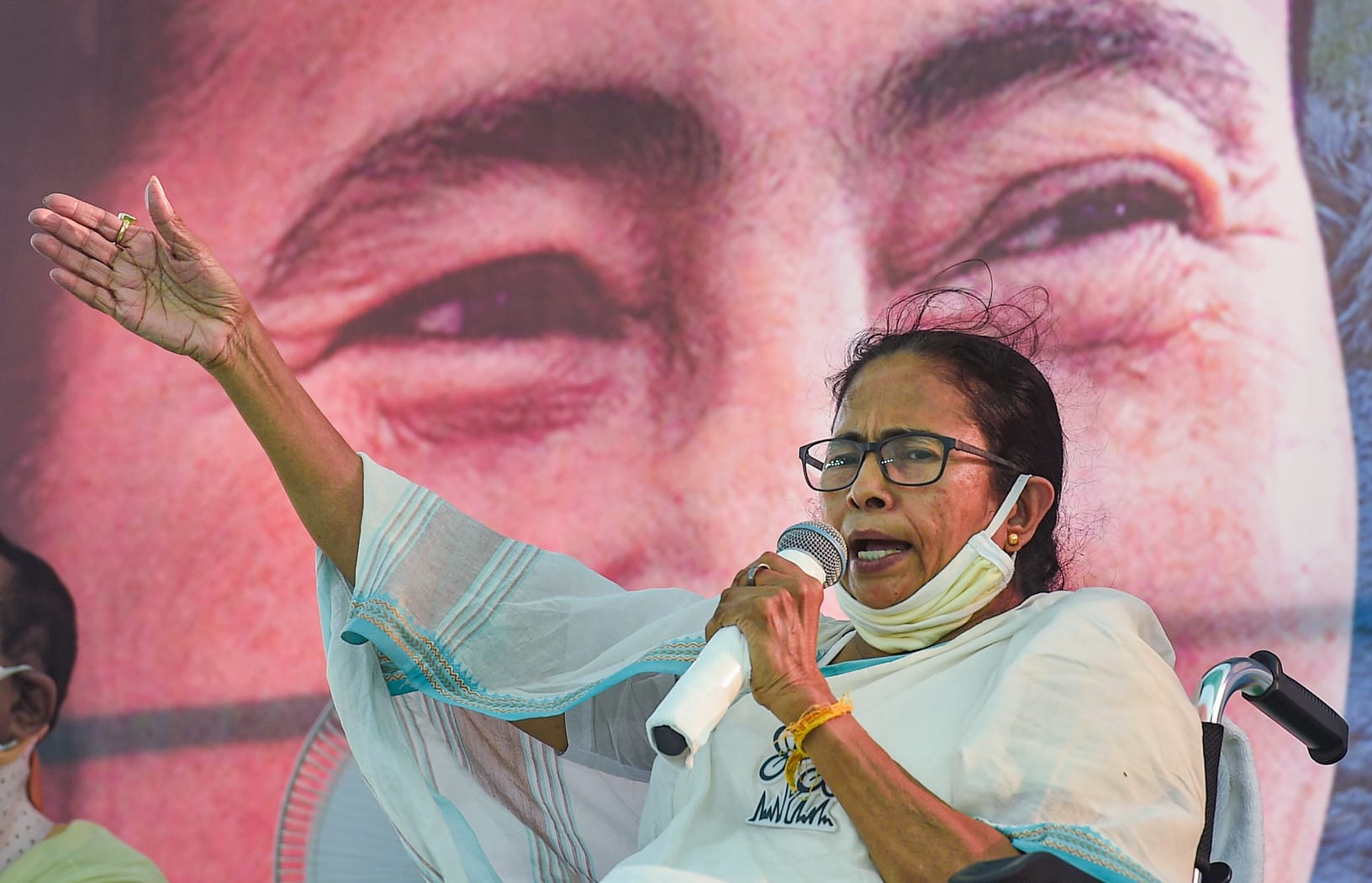 Mamata Banerjee addresses a gathering during her rally on Tuesday.