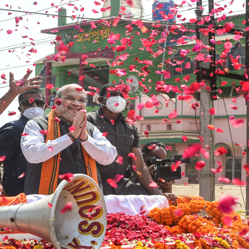 Amit Shah folds hands as he greets supporters at his Nandigram roadshow on Tuesday.