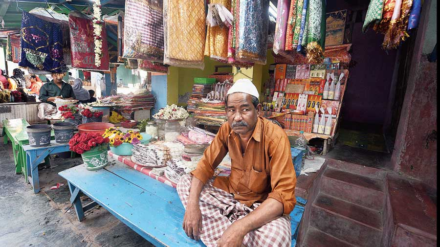 Salim Dewan, 65, who owns a store selling incense sticks, flowers, chadars and other  objects offered to the Pir's resting place