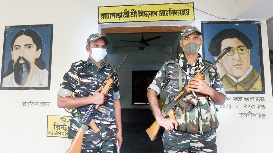 Security personnel at a polling booth in Nandigram on Wednesday