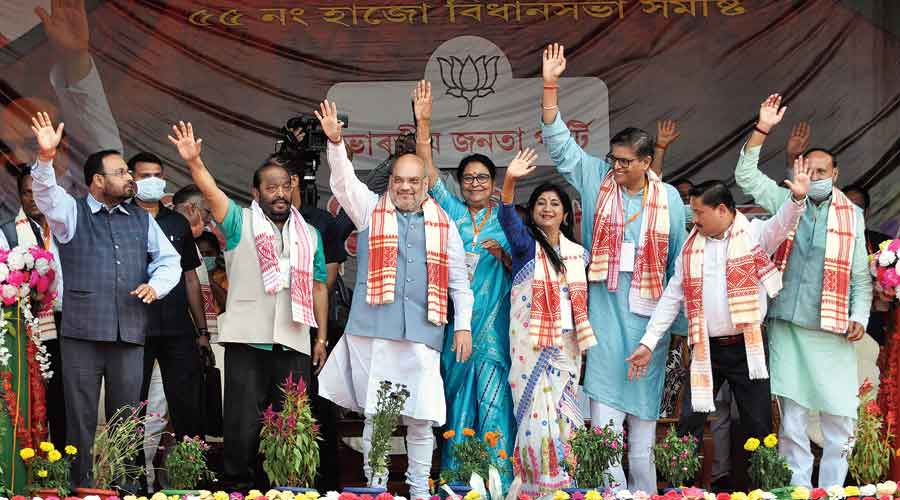 Union home minister Amit Shah and other BJP leaders wave at the crowd during an election rally at Hajo in Kamrup district of Assam on Wednesday.