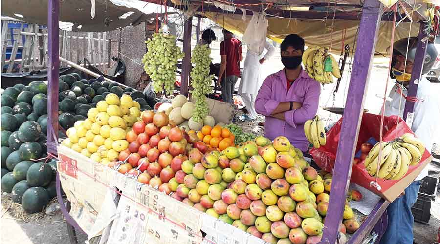 A fruit seller waits for customers in Bistupur, Jamshedpur on Saturday.