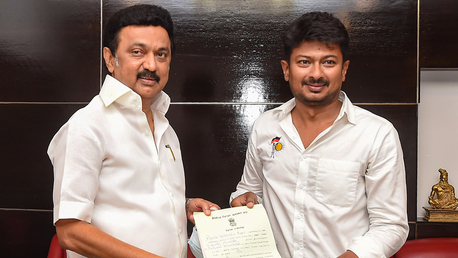 DMK youth wing secretary Udhayanidhi Stalin shares his victory with his father and party president MK Stalin after winning the Tamil Nadu Assembly polls at his residence ,in Chennai, Sunday, May 2, 2021.