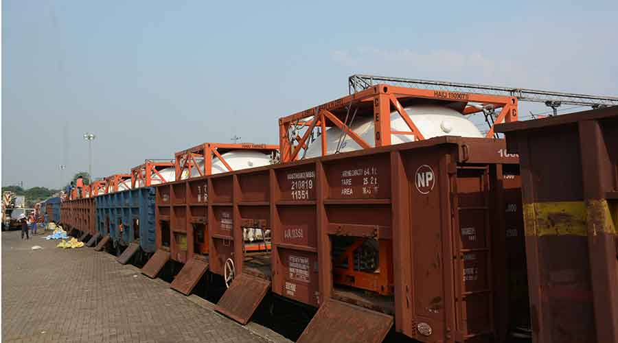 Containers carrying liquid medical oxygen being loaded in wagons at the Tatanagar railway yard on Monday.