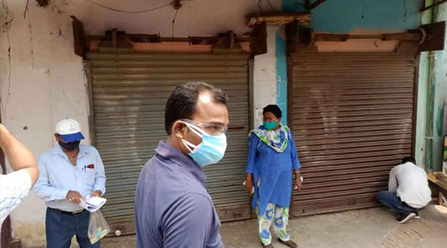 A team of government officials seal shops in Barkatha on Monday.