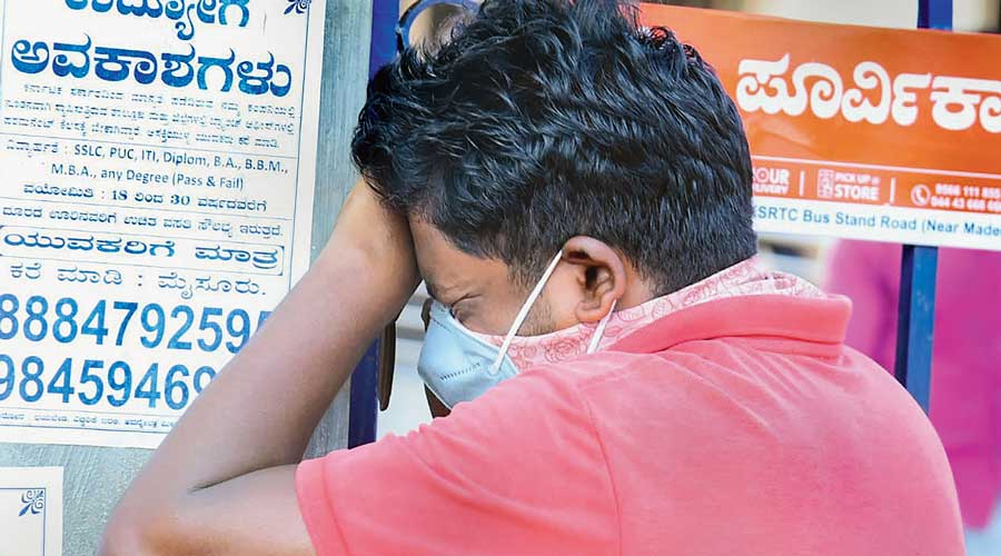 A relative of a victim grieves in Chamrajnagar, Karnataka, on Monday.