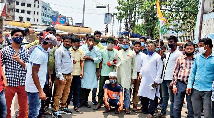 Trinamul workers block the road near the centre where Nandigram votes were counted