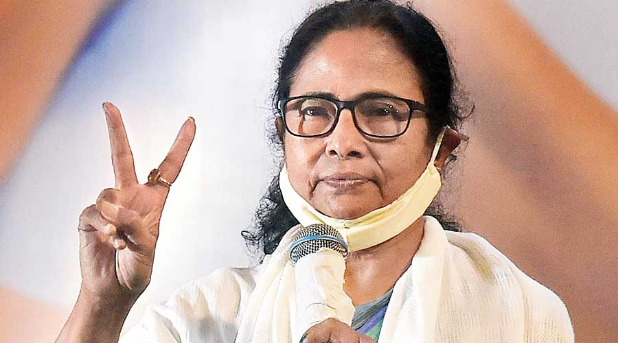 Mamata Banerjee flashes the victory sign in Calcutta  on Sunday.