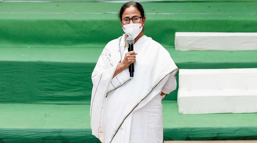 Mamata Banerjee addressing journalists at her home on Monday.