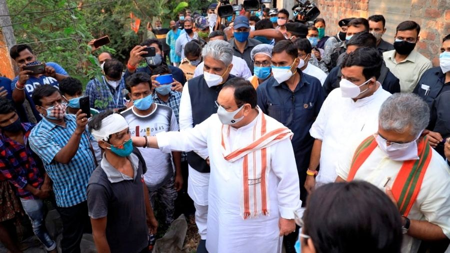JP Nadda visits families of victims of post-poll violence in Sonarpur on Tuesday.