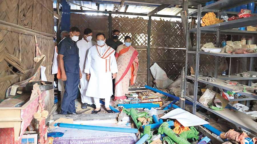 Nadda visits the ransacked shop of a  BJP worker at Narendrapur in South  24-Parganas.