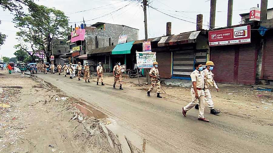 Security personnel take out a route march at a locality in Chopra block, North Dinajpur, on Tuesday.