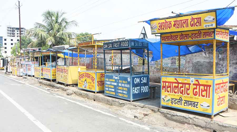 Empty fast food carts stand idle in front of the Ozone Galleria Mall at Saraidhela-Govindpur road in Dhanbad on Friday.