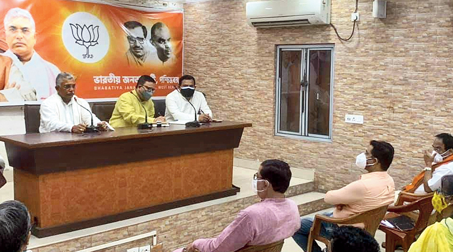 Dilip Ghosh (left) presides over an organisational meeting of the BJP in Calcutta on Friday.