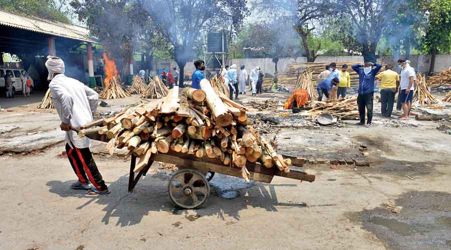 Relatives cremate bodies of Covid-19 victims at the Ghazipur crematorium  on Friday.