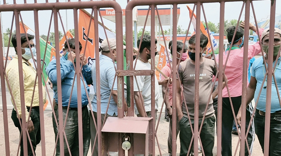 Trinamul workers stage a dharna outside the factory in Haldia on Thursday.