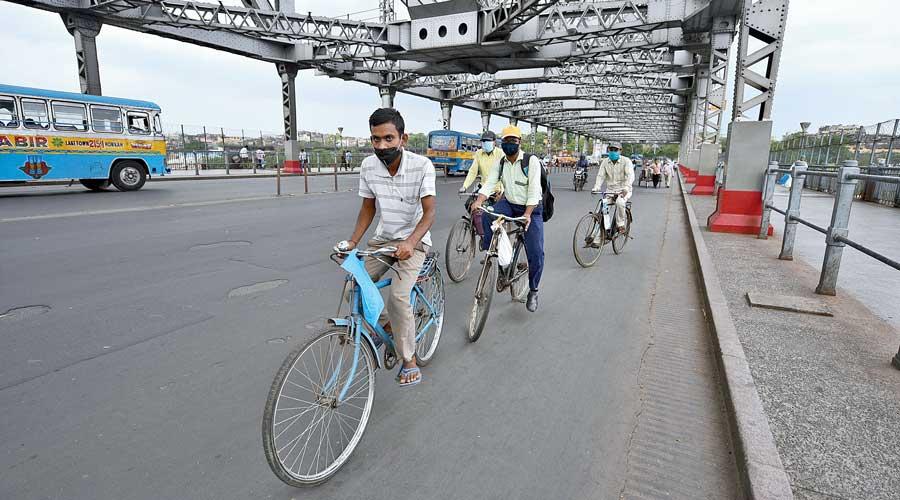 Cyclists on Howrah bridge on Friday.
