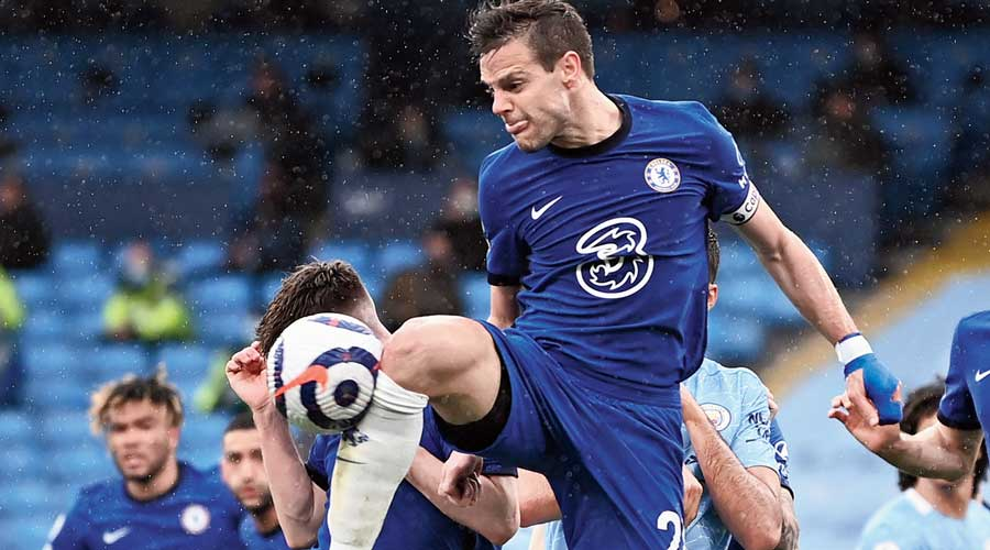 Chelsea's Cesar Azpilicueta clears the ball during the EPL match against  Manchester City at Etihad Stadium on Saturday.