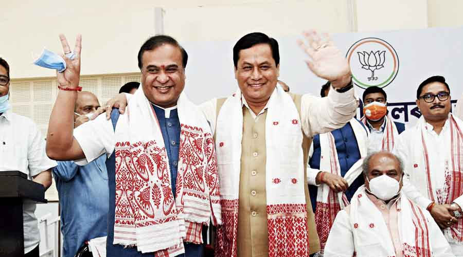 Himanta Biswa Sarma (left) being greeted by caretaker chief minister Sarbananda Sonowal after being elected the BJP's legislative party leader during the party's legislative party meeting in Guwahati on Sunday.