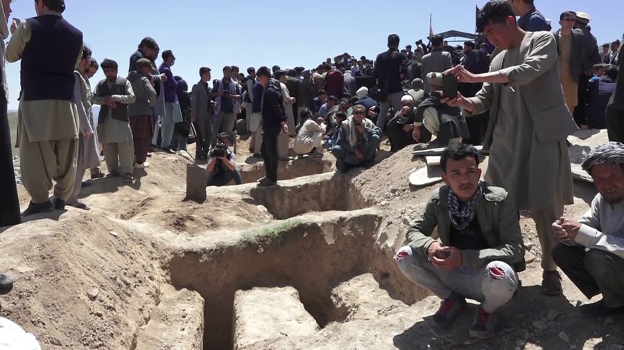 Victims of Kabul school bombing, being laid to rest.