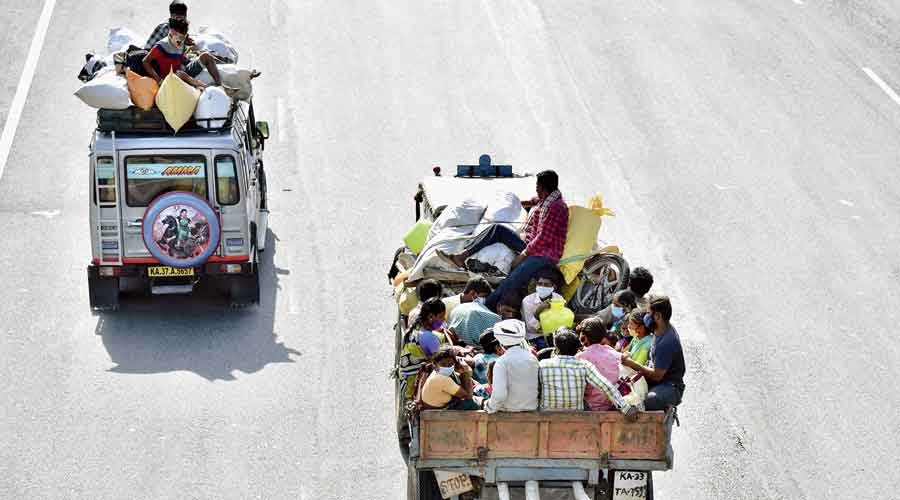 Migrant workers leave Bangalore hours before the lockdown on Sunday.