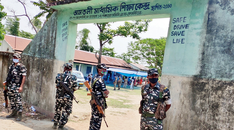 CAPF personnel guard Sitalkuchi's booth 126/5 on the day of repolling on April 29.